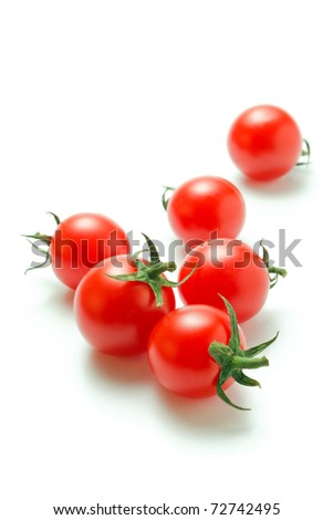 Fresh ripe cherry tomatoes scattered isolated on a white background - stock photo