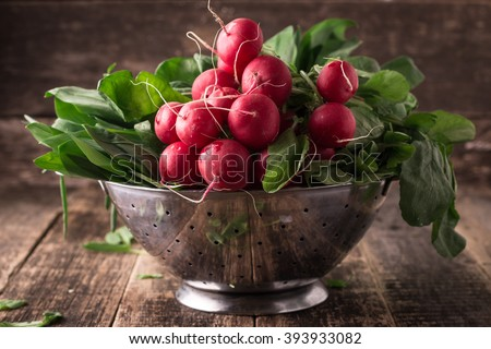 fresh vegetables in a metal colander ,healthy food on a wooden vintage table - stock photo