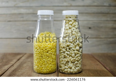 Fresh yellow beans  Millet the organic grain food arranges as background - stock photo