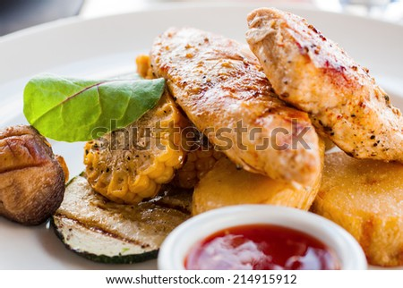Fried chicken meat with vegetables
