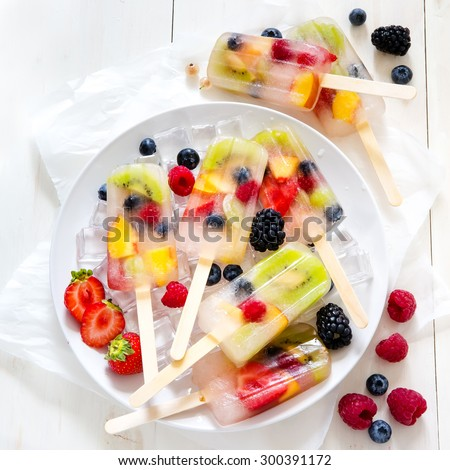Fruit Popsicles with Berries Kiwi and Peaches - stock photo
