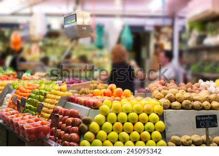 Fruits and vegetables on counter at european market  - stock photo