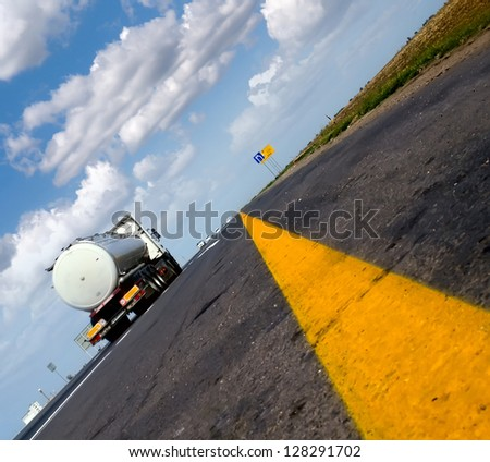 fuel gas tanker truck on highway - stock photo