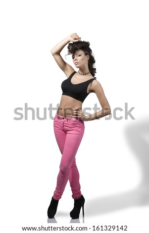 full-length portrait of fashion woman with curly creative hair-style, black top, pink treasure and heels in sexy pose