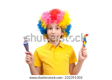 funny boy wears colorful wig holding a wooden clowns  - stock photo