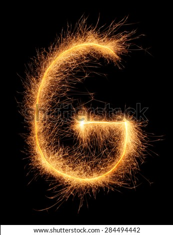 """G"" letter drawn with bengali sparkles isolated on black background - stock photo"