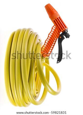 garden hose coiled with spray nozzle - stock photo