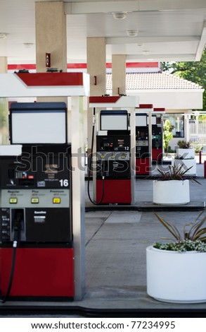 4 gas pumps across different islands without cars - stock photo