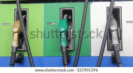gasoline station in Thailand ,Detail fuel pump at auto gas station, background, green energy