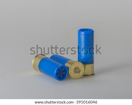 12 gauge shotgun shells used for hunting  on gray gradient background - stock photo