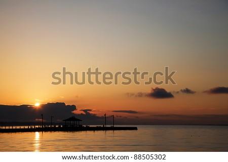 Gazebo and sunrise at Mascot Pier, Patchogue, Long Island, New York. - stock photo