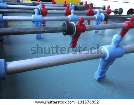"""Geek"" - Table football - perceberitos, foosball,TABLE SOCCER GAME - Antique Toy - Dolls players - metal - red, blue - stock photo"