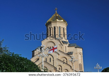 Georgian flag in the background cathedral of the Georgian Orthodox Church located in Tbilisi - stock photo