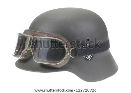 German Army helmet with protective goggles World War II period isolated on a white background