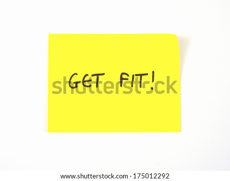 'Get Fit' written on a yellow sticky note - stock photo
