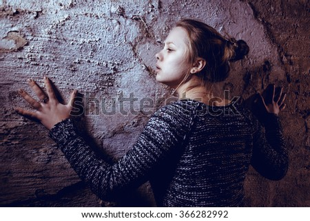 girl at the old wall - stock photo