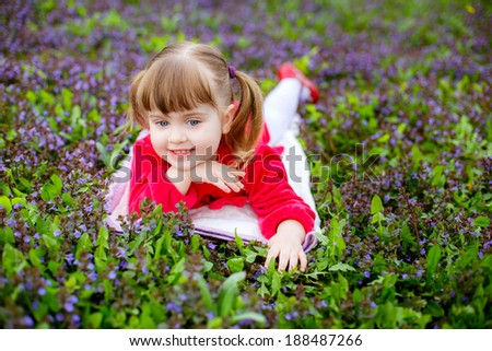 girl. child walking in the park. meadow with flowers, child smelling flowers