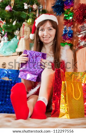 girl dressed like Snow Maiden with christmas presents - stock photo