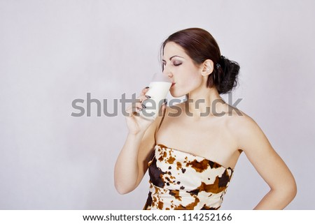 Girl drinking milk - stock photo