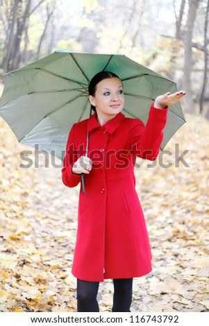 girl in the autumn forest with umbrella - stock photo