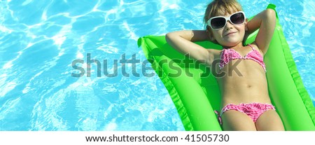 girl near the swimming pool in  sun glasses