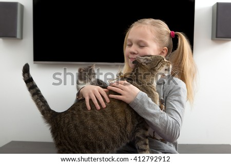 girl petting cat, girl with her cat