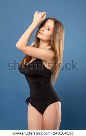 girl with big breasts posing in a swimsuit
