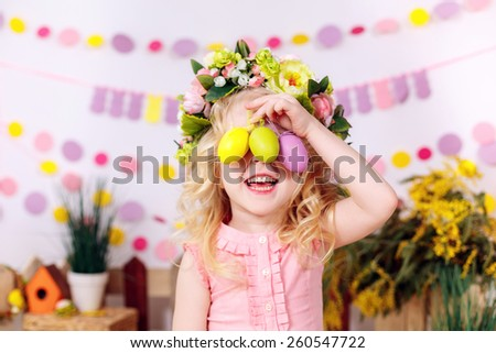girl with easter eggs, smiling, easter decor - stock photo