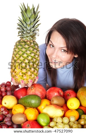 Girl with group of fruit and  pineapple. Isolated.