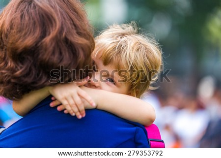 Girl with her mother in the garden - stock photo