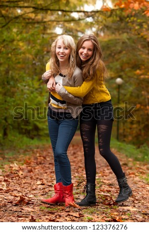 2 girls are having fun in the forest - stock photo