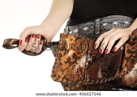 Glamorous girl with fashion accessories, bag and hand with red nail polish  - stock photo