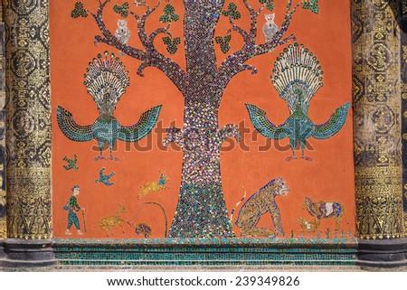 Glass mosaic at wat xieng thong temple wall, Luang prabang,Laos - stock photo
