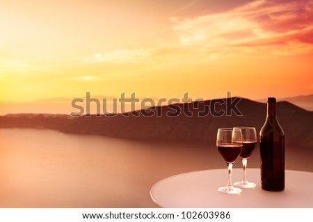 2 glasses of red wine and beautiful sunset - stock photo