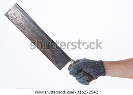 gloves on hand holding a saw.