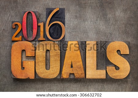 2016 goals - New Year resolution concept - text in vintage letterpress wood type blocks against grunge metal background - stock photo