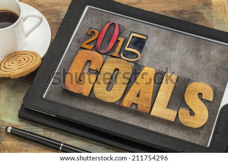 2015 goals - New Year resolution concept - text in vintage letterpress wood type on a digital tablet screen - stock photo