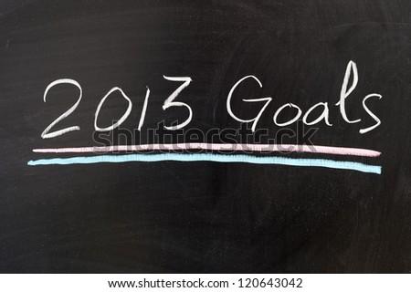 2013 goals words written on the chalkboard - stock photo