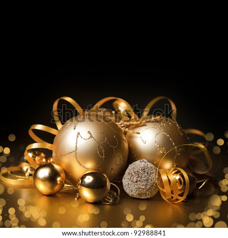 gold christmas balls with black background - stock photo
