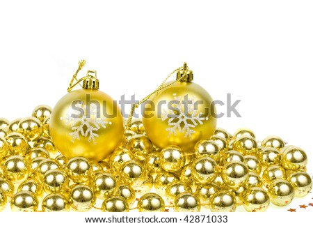 Golden Christmas balls with snowflake isolated on white background with copy space - stock photo