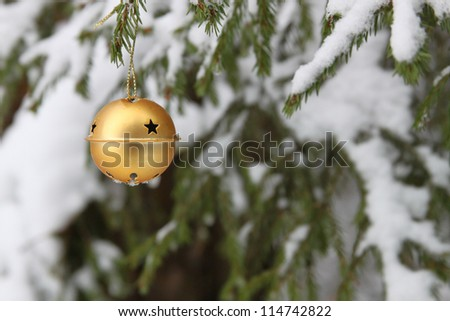 Golden christmas bell on the pine - stock photo