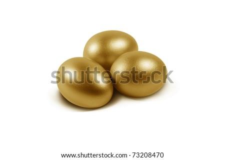 3 golden eggs on white background - stock photo