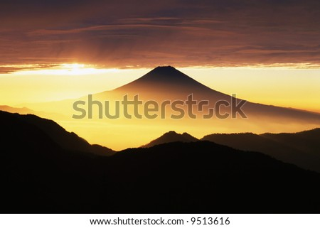 Golden sunrise over Mt. Fuji as viewed from an adjacent peak - stock photo