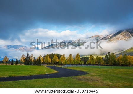 Golf courses in Banff. Gorgeous autumn in the Rocky Mountains - stock photo