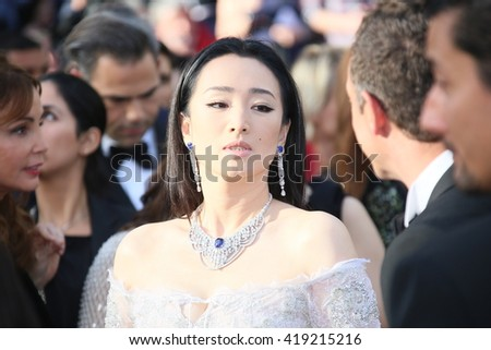 Gong Li attends the 'Cafe Society' premiere and the Opening Night Gala during the 69th Cannes Film Festival at the Palais des Festivals on May 11, 2016 in Cannes, France. - stock photo