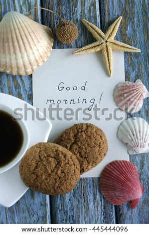 """Good morning"" is written on small paper with a cup of coffee"