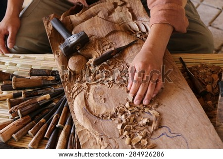 And carving tools on wooden workbench travel chiang mai stock photo