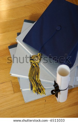 2007 graduation cap and books - stock photo