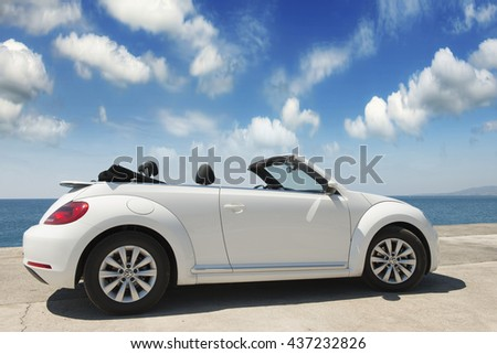 GREECE. ISLAND RODOS- June 16, 2013. The car is a Volkswagen convertible on the waterfront of the city of Rhodes test drive. Greece, Rhodes - stock photo
