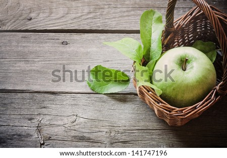green apple on wooden background - stock photo